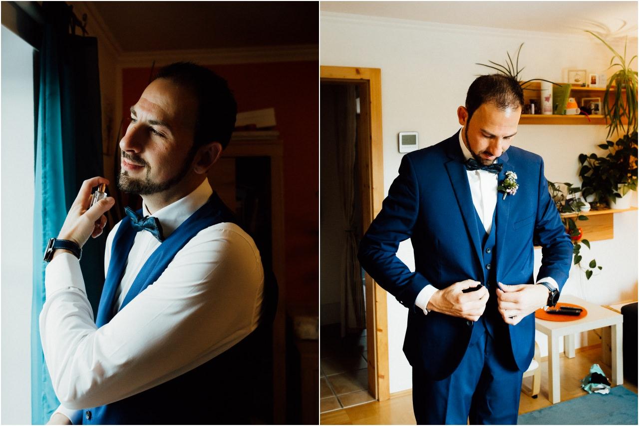 Die letzte Phase der Vorbereitungen des Bräutigams für die Hochzeit. Parfüm und knöpft seine Jacke zu.